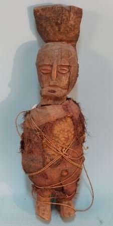 CARVED AFRICAN MALE WRAPPED IN CLOTH