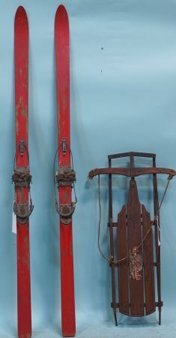 PAIR OF ANTIQUE SNOW SKIS AND A SLED