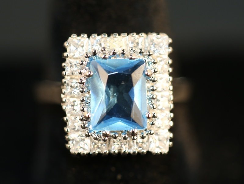 S. S. BLUE TOPAZ DINNER RING WITH WHITE SAPPHIRE A