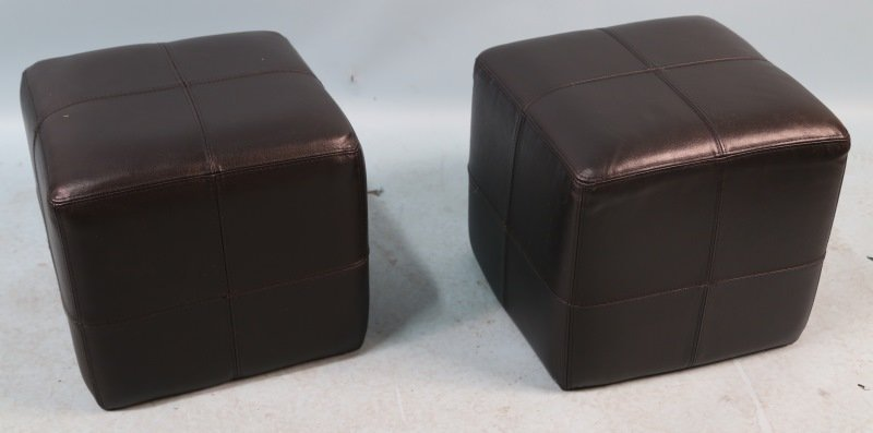 PAIR OF BLACK LEATHER OTTOMANS