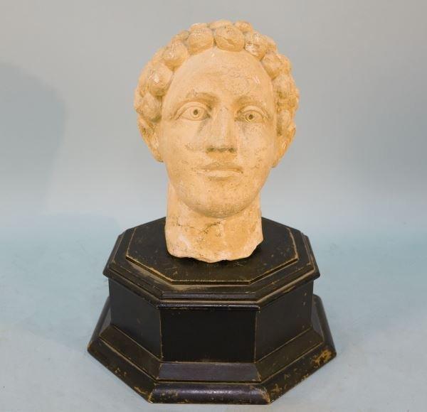 ANCIENT CARVED LIMESTONE ROMAN FEMALE HEAD