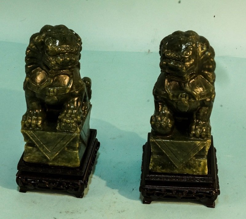 PAIR OF CARVED SERPENTINE FOO DOGS ON STAND
