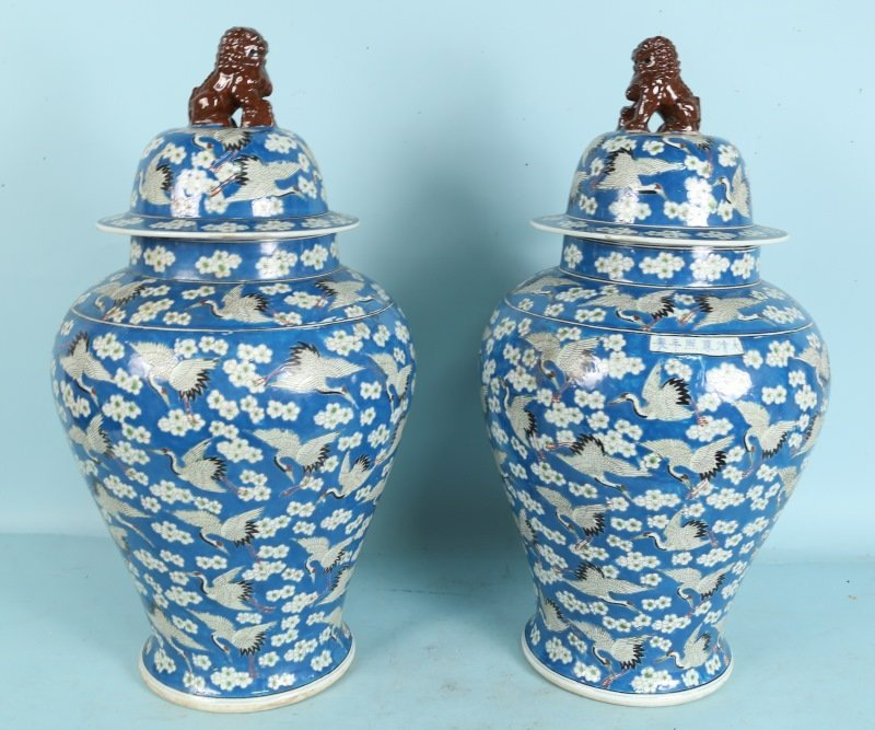 PAIR OF VINTAGE BLUE AND WHITE LIDDED TEMPLE JARS
