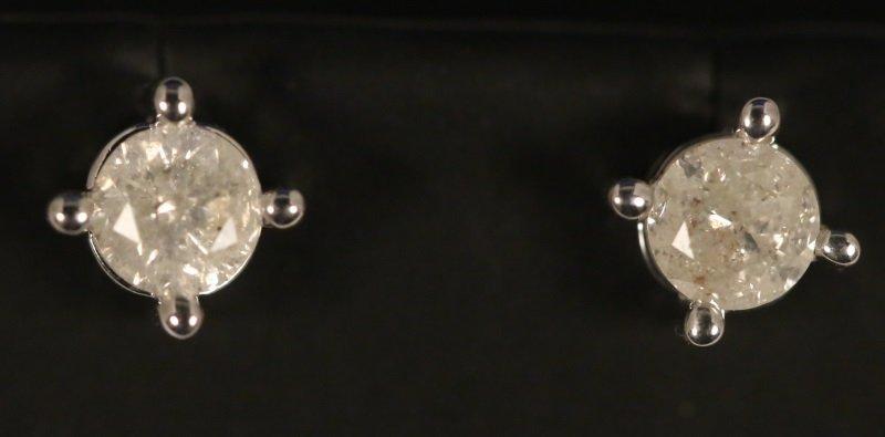 PAIR OF STERLING SILVER DIAMOND SOLITIARE EARRINGS