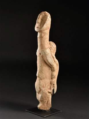 A Stone Maternity Figure