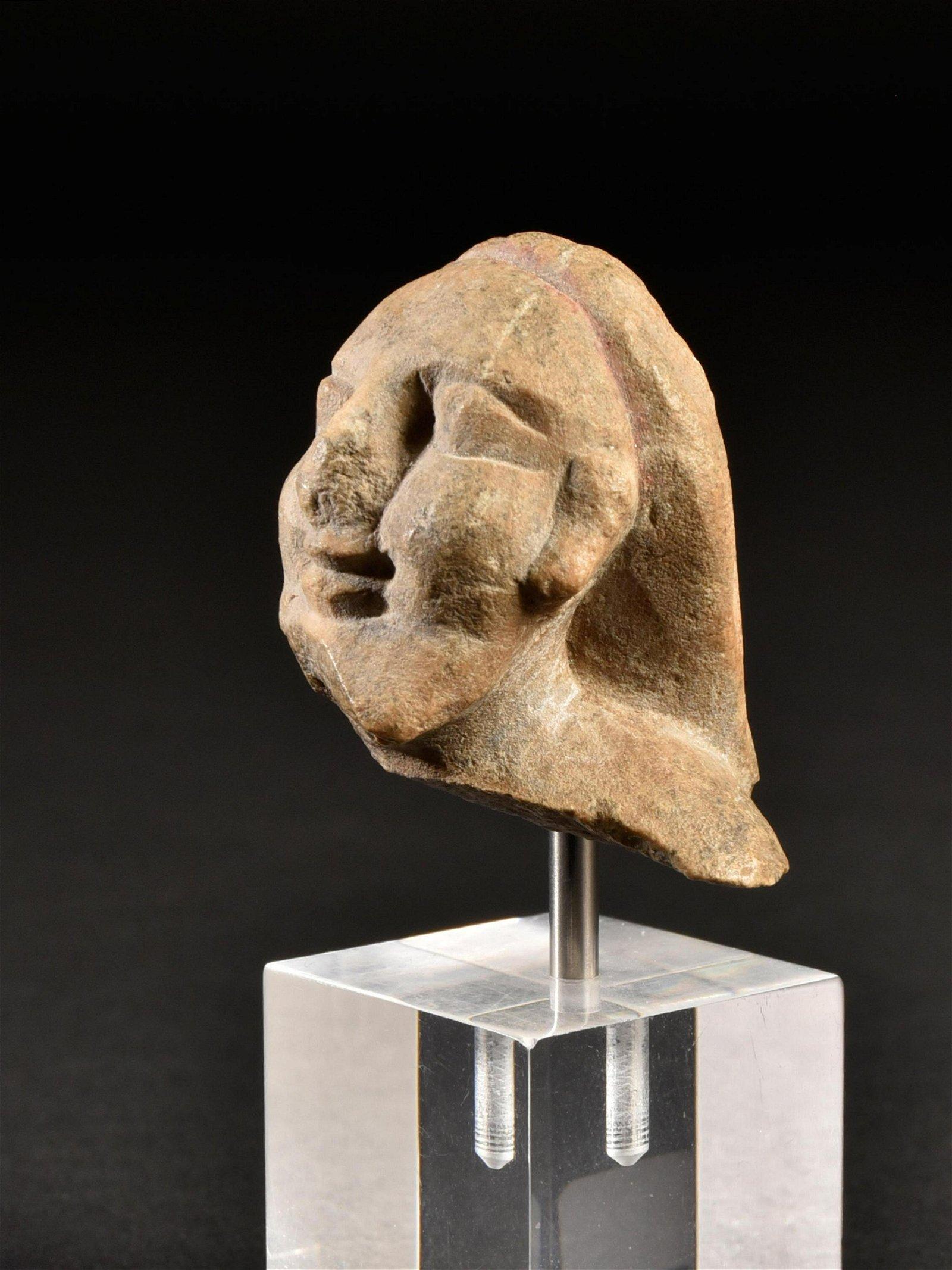 An Archaic Bearded Head
