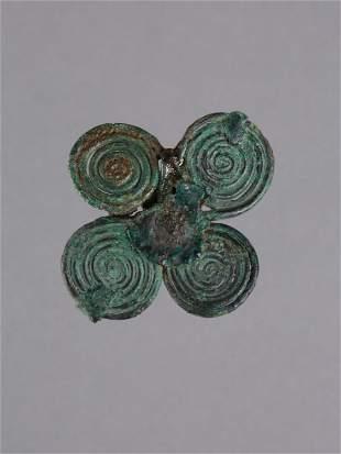 An Etruscan Four-Leaf Spiral Fibula