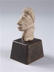 A kneeling Figure