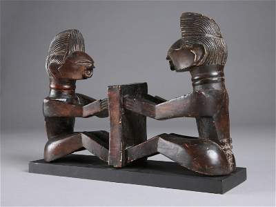 A Songye Pair of seated Figures