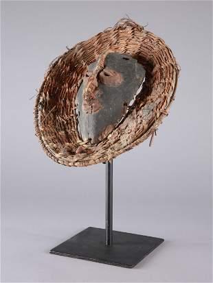A Sepik Bone Mask in Basket