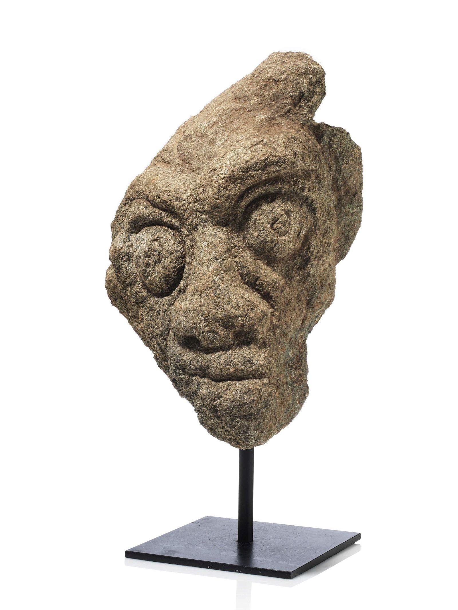 A Pre-Senufo monumental Stone Head