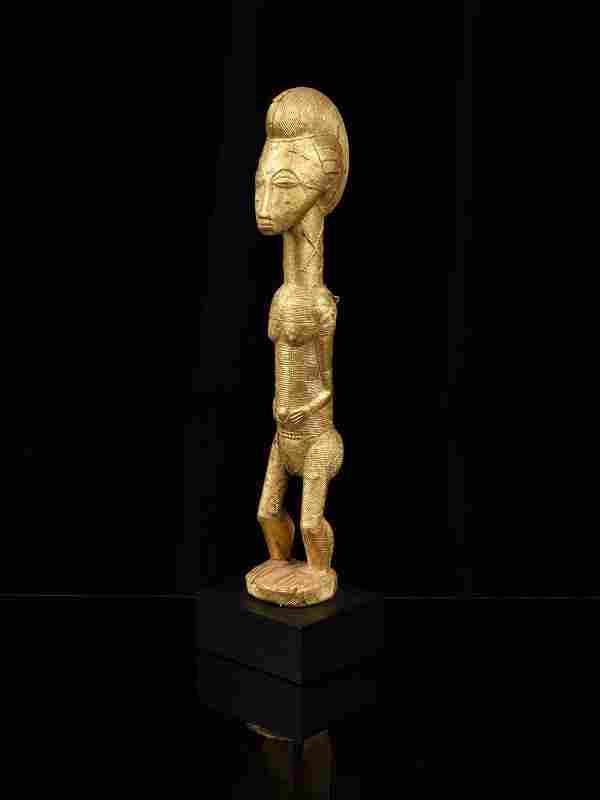 """A Baule Figure, """"sika blawa"""""""