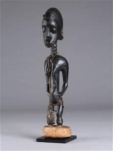 """A Baule Figure, """"waka sona"""" (""""blolo-bian"""")"""
