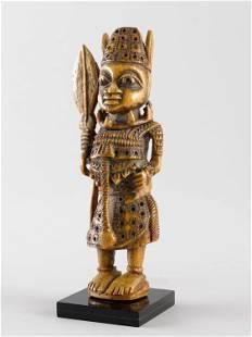 A Yoruba-Owo Ivory Figure of a Notable