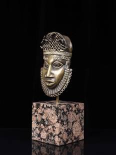 """An Edo Pendant Mask, """"uhunmwun-ekhue"""""""