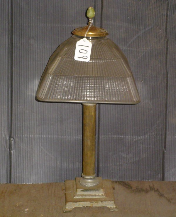 1109: IRON AND BRASS HOLOPHANE TABLE LAMP