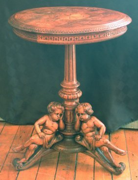 SMALL TABLE W/THREE LEGGED CUPID BASE  15628