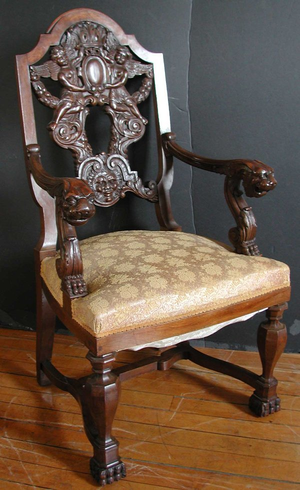 310: ANTIQUE CARVED WALNUT CHAIR W/ LION HEAD ARMS 1167