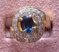 246 14 K GOLD RING WITH DIAMOND SWIRL AND LG SAPHIRE