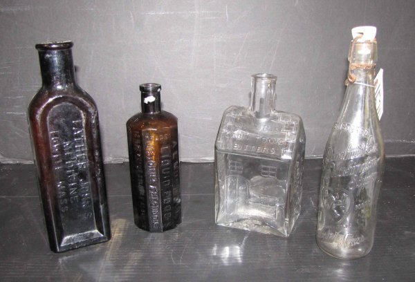 12: 4 BOTTLES; 3 ANTIQUE AND 1 REPRO. OF LOG CAB 1524