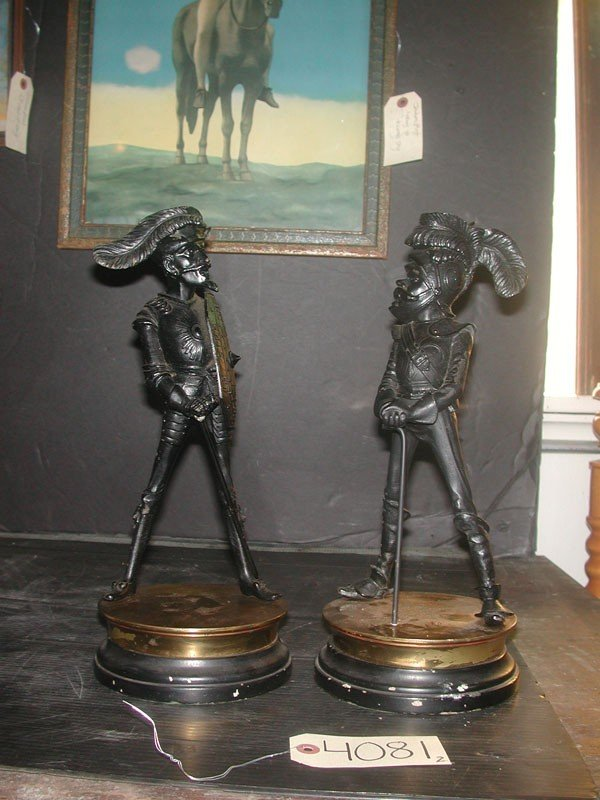 55: 2 DETAILED SPELTER CANDLESTICKS OF MUSKETEERS 4081