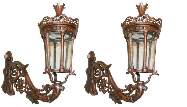 142: PAIR OF CAST IRON EXTERIOR WALL LANTERNS 4335A