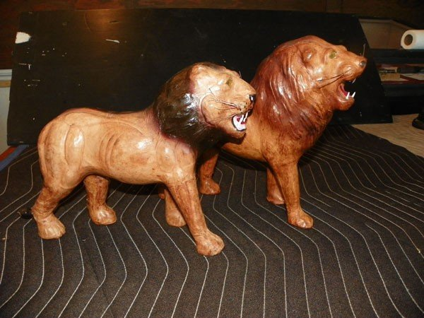 264: 2 LEATHER LION STATUES 2160