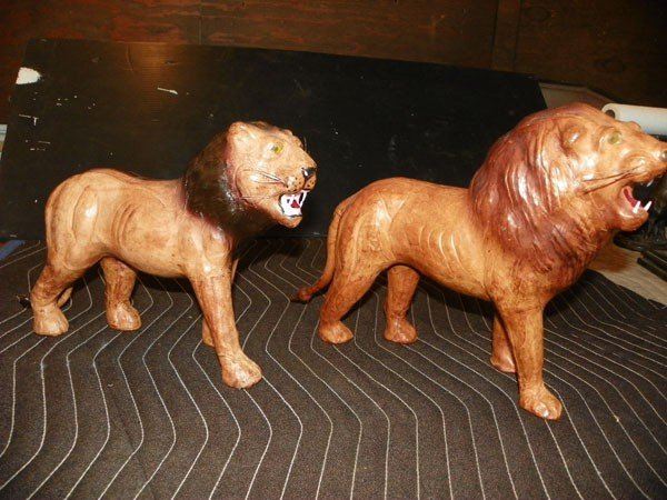264: 2 LEATHER LION STATUES 2160 - 2