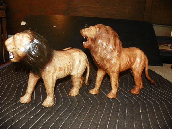264: 2 LEATHER LION STATUES 2160 - 3