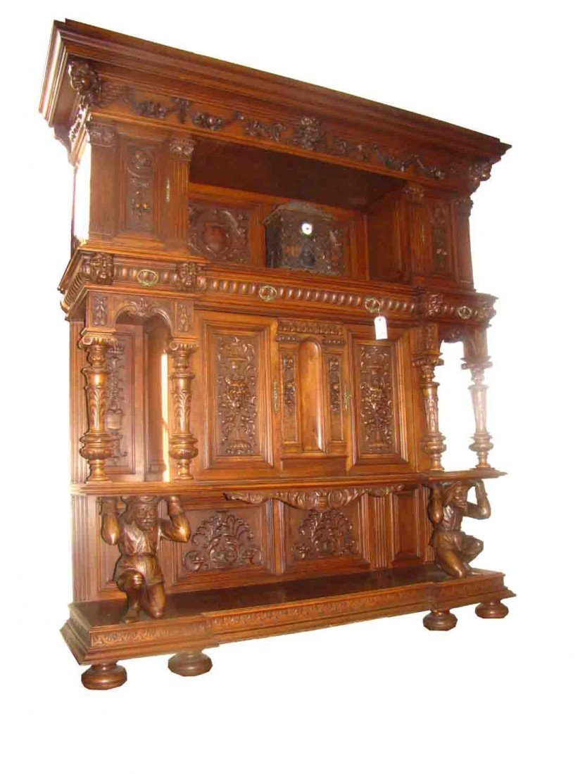 580: COLOSSAL CARVED WALNUT CABINET W/MEN SUPORTS 14431