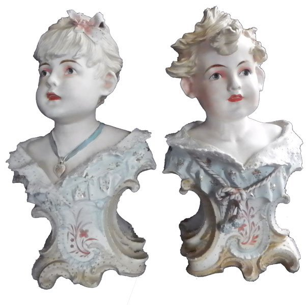 53: PAIR OF PORCELIAN BUST OF BOY AND GIRL 1646