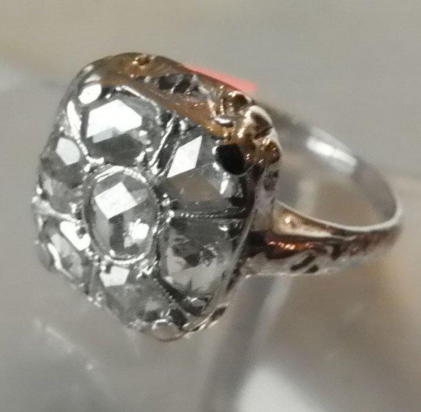 155: 7 STONE DIAMOND RING SET IN 14K WHITE GOLD 1559