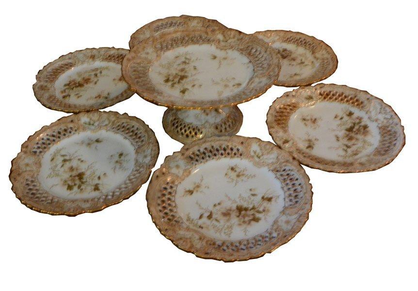 157: 7 PIECE FLORAL MOTIF PORCELAIN CAKE SET 1598