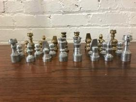 A Brass and Aluminum Modernist Hand Tooled Chess Set