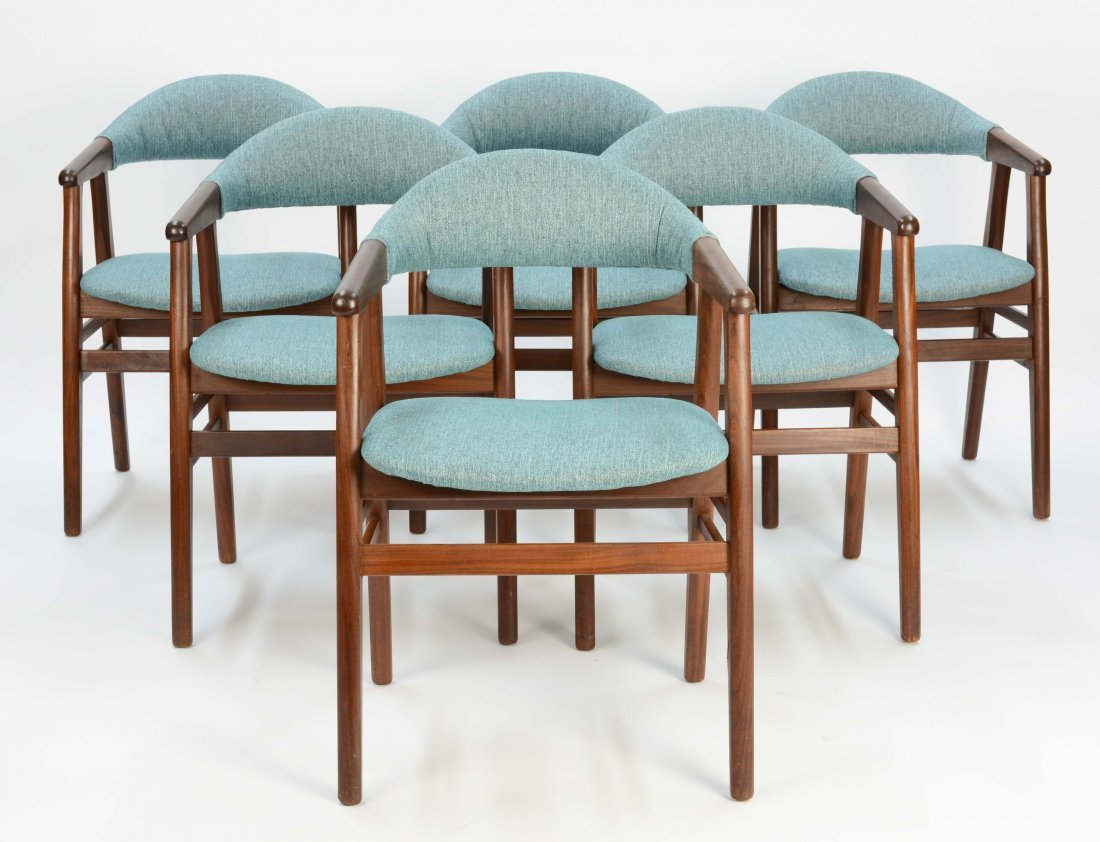 A set of 6 Danish Arm Chairs after Kai Kristansen