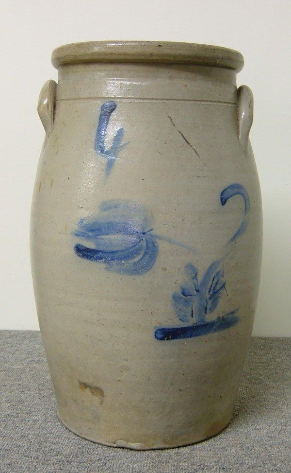 244: 4-gallon butter churn w/ cobalt flower. Nice decor