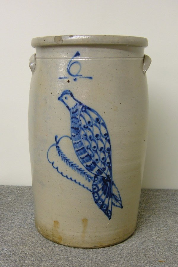 249: Six-gallon cobalt decorated butter churn with a do