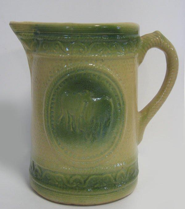 1: Three stoneware pitchers. Green trimmed stoneware pi