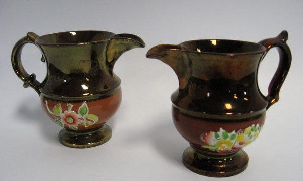 5: Pair of Copper Lustre creamers with burnt orange ban