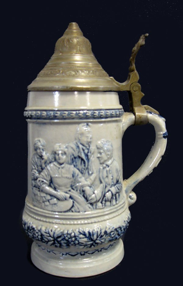 10: Stoneware German stein with relief family scene and