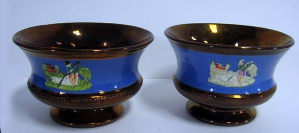 11: Pair of Copper Lustre bowls with blue bands and emb