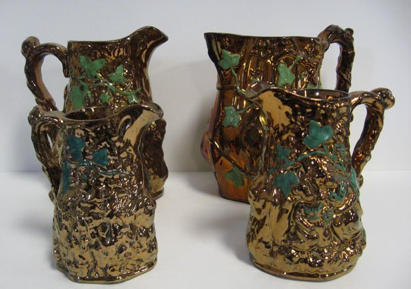 13: Four Foliage jugs. ''Babes in the Woods'' shaped in