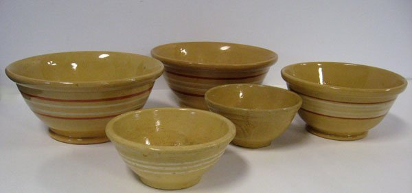 6: Lot of five yellow ware mixing bowls with applied ge