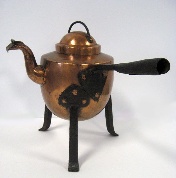 13: Hand hammered copper and iron tea pot. Appropriate