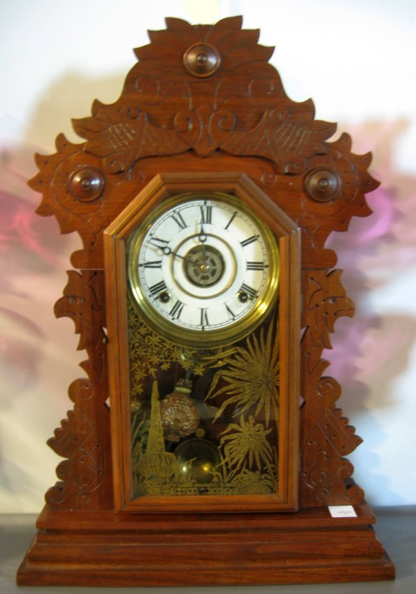 17: E. Ingraham gingerbread mantel clock, walnut with r