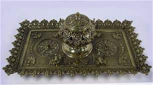 64: Brass inkwell. Large ornate Victorian brass inkwell