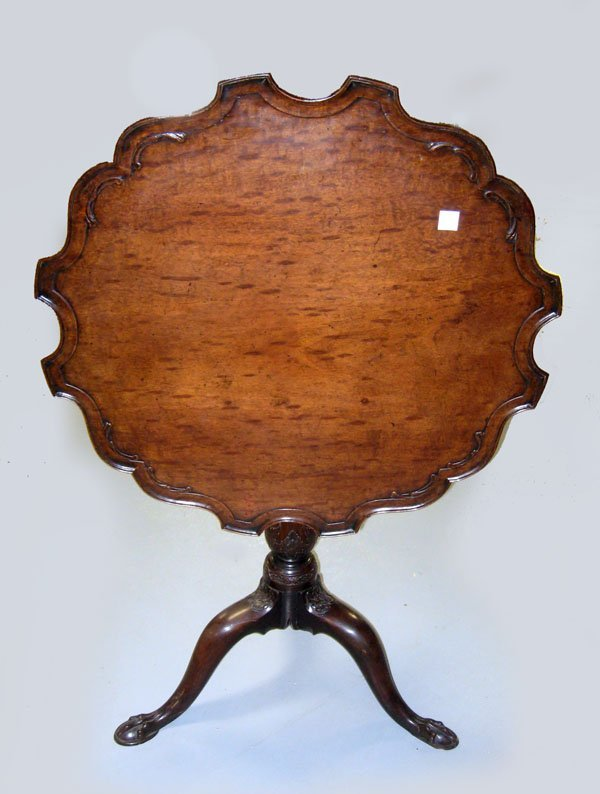 George III mahogany tilt top table with claw feet and s
