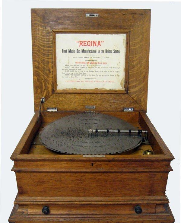 Regina disc music box with nine 15 1/2'' disks in worki