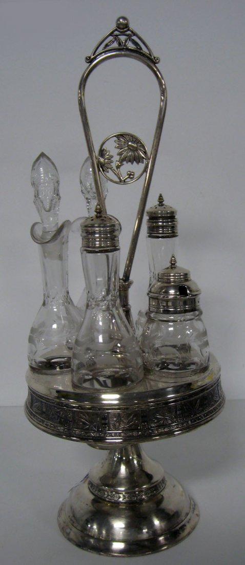 Victorian caster set with silverplate holder. Note dama