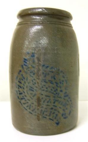 12: Stoneware crock with blue script